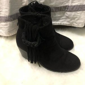 Black heeled booties with fringe